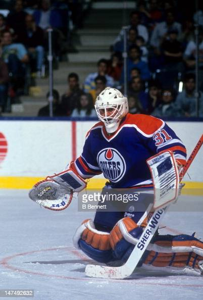 Goalie Grant Fuhr of the Edmonton Oilers looks to make the save during an NHL game circa 1988