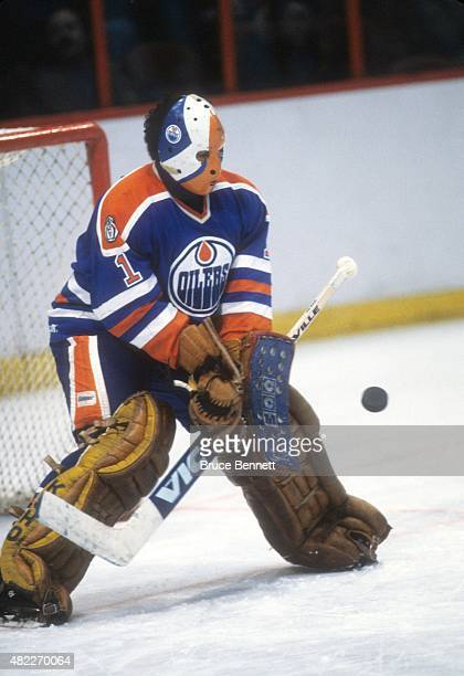 Goalie Grant Fuhr of the Edmonton Oilers looks to make the save during an NHL game against the Philadelphia Flyers on January 14 1982 at the Spectrum...