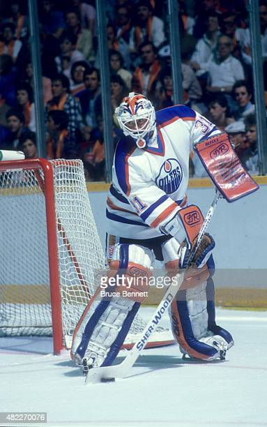 Goalie Grant Fuhr of the Edmonton Oilers looks to pass the puck during an 1987 Stanley Cup Finals game against the Philadelphia Flyers in May 1987 at...