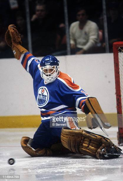 Goalie Grant Fuhr of the Edmonton Oilers makes the save during an NHL game against the New York Rangers in 1981 at the Madison Square Garden in New...