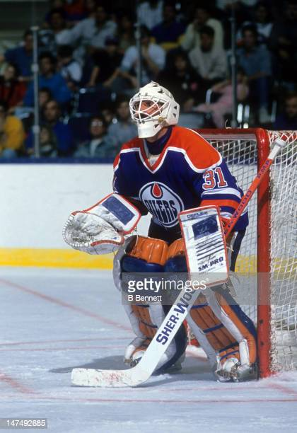 Goalie Grant Fuhr of the Edmonton Oilers makes the save during an NHL game circa 1988