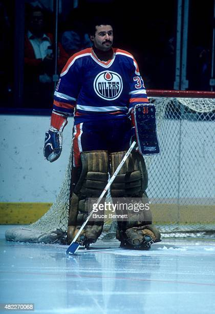 Goalie Grant Fuhr of the Edmonton Oilers stands on the ice before a1984 Stanley Cup Finals game against the New York Islanders in May 1984 at the...