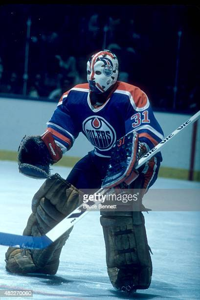 Goalie Grant Fuhr of the New York Islanders defends the net during an NHL game against the New York Islanders on March 26 1985 at the Nassau Coliseum...
