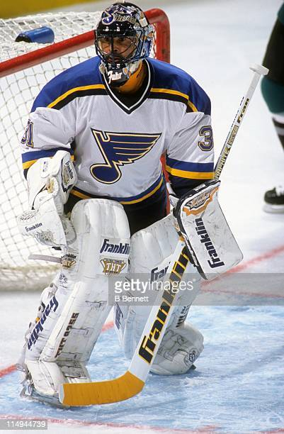 Goalie Grant Fuhr of the St Louis Blues defends the net during an NHL game against the San Jose Sharks on February 11 1999 at the Kiel Center in St...