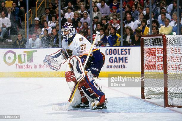 Goalie Grant Fuhr of the St Louis Blues defends the net during an NHL game in March 1996 at the Kiel Center in St Louis Missouri