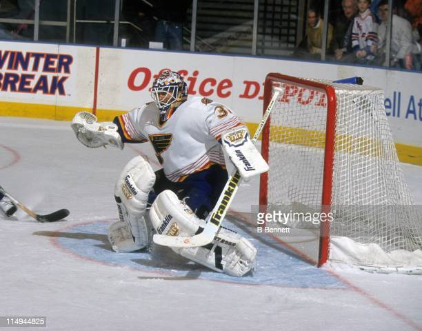 Goalie Grant Fuhr of the St Louis Blues defends the net during an NHL game against the New York Rangers on January 20 1998 at the Madison Square...