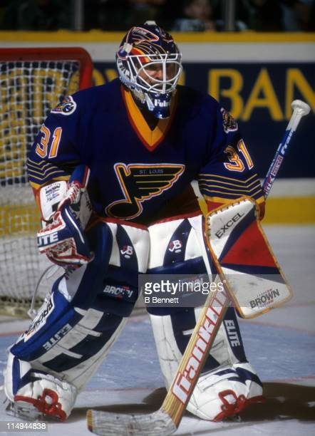 Goalie Grant Fuhr of the St Louis Blues defends the net during an NHL game in December 1996