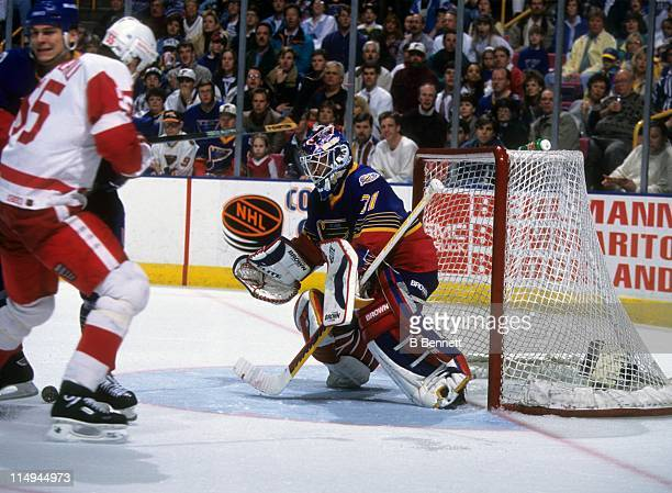 Goalie Grant Fuhr of the St Louis Blues looks to dive on the puck during an NHL game against the Detroit Red Wings on March 24 1996 at the Kiel...