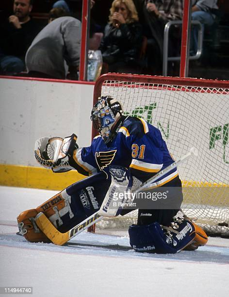 Goalie Grant Fuhr of the St Louis Blues makes the save during an NHL game against the Philadelphia Flyers on October 27 1998 at the First Union...