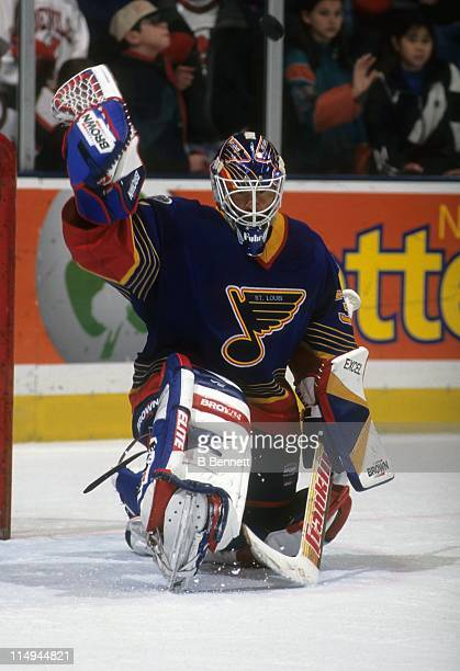 Goalie Grant Fuhr of the St Louis Blues makes the save during an NHL game against the New Jersey Devils circa 1997 at the Contenental Airlines Arena...