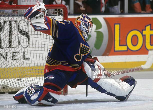 Goalie Grant Fuhr of the St Louis Blues makes the save during an NHL game in 1997
