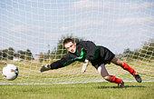 Goalie guarding soccer goal