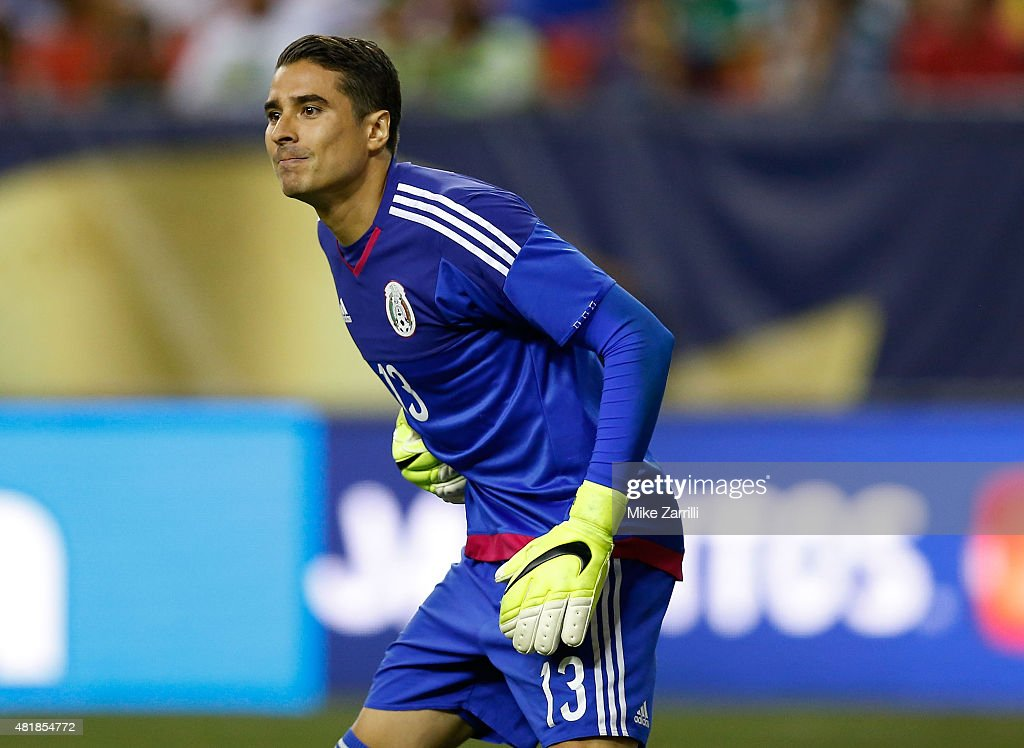 Goalie <a gi-track='captionPersonalityLinkClicked' href=/galleries/search?phrase=Guillermo+Ochoa&family=editorial&specificpeople=490875 ng-click='$event.stopPropagation()'>Guillermo Ochoa</a> #13 of Mexico waits for a free kick during the 2015 CONCACAF Gold Cup semifinal match against Panama at Georgia Dome on July 22, 2015 in Atlanta, Georgia.