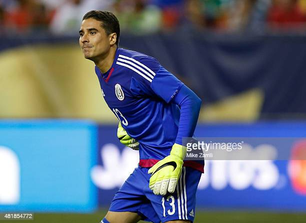 Goalie Guillermo Ochoa of Mexico waits for a free kick during the 2015 CONCACAF Gold Cup semifinal match against Panama at Georgia Dome on July 22...