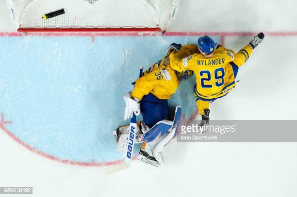 Goalie Henrik Lundqvist and William Nylander celebrates the win over Canada during the Ice Hockey World Championship Gold medal game between Canada...