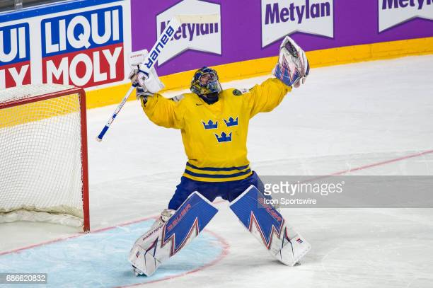 Goalie Henrik Lundqvist celebrates the win during the Ice Hockey World Championship Gold medal game between Canada and Sweden at Lanxess Arena in...