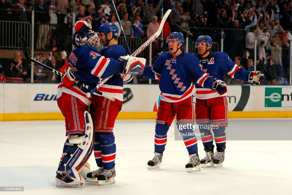 Goalie <a gi-track='captionPersonalityLinkClicked' href=/galleries/search?phrase=Henrik+Lundqvist&family=editorial&specificpeople=217958 ng-click='$event.stopPropagation()'>Henrik Lundqvist</a> #30, Dan Girardi #5, <a gi-track='captionPersonalityLinkClicked' href=/galleries/search?phrase=Ryan+McDonagh&family=editorial&specificpeople=4324983 ng-click='$event.stopPropagation()'>Ryan McDonagh</a> #27 and <a gi-track='captionPersonalityLinkClicked' href=/galleries/search?phrase=Brad+Richards&family=editorial&specificpeople=202622 ng-click='$event.stopPropagation()'>Brad Richards</a> #19 of the New York Rangers celebrate after they won 2-1 against the Washington Capitals in Game Seven of the Eastern Conference Semifinals during the 2012 NHL Stanley Cup Playoffs at Madison Square Garden on May 12, 2012 in New York City.