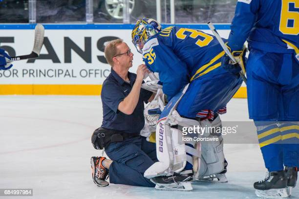 Goalie Henrik Lundqvist gets a medical treatment during the Ice Hockey World Championship Quarterfinal between Switzerland and Sweden at AccorHotels...