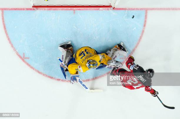 Goalie Henrik Lundqvist makes a save against Brayden Point in penalty shoot outs during the Ice Hockey World Championship Gold medal game between...