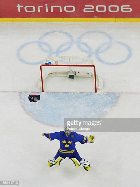 Goalie Henrik Lundqvist of Sweden celebrates defeating Finland 32 to win the gold medal in the final of the men's ice hockey match between Finland...