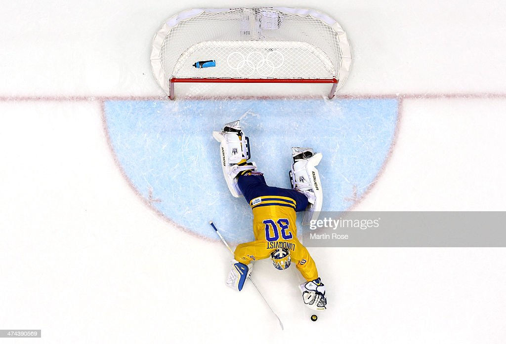 Goalie <a gi-track='captionPersonalityLinkClicked' href=/galleries/search?phrase=Henrik+Lundqvist&family=editorial&specificpeople=217958 ng-click='$event.stopPropagation()'>Henrik Lundqvist</a> #30 of Sweden dives onto the puck during the Men's Ice Hockey Gold Medal match on Day 16 of the 2014 Sochi Winter Olympics at Bolshoy Ice Dome on February 23, 2014 in Sochi, Russia.