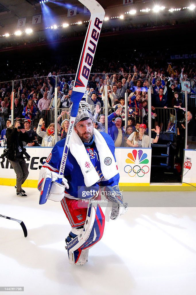 Goalie <a gi-track='captionPersonalityLinkClicked' href=/galleries/search?phrase=Henrik+Lundqvist&family=editorial&specificpeople=217958 ng-click='$event.stopPropagation()'>Henrik Lundqvist</a> #30 of the New York Rangers celebrates after he was named a star of the game after the Rangers won 2-1 against the Washington Capitals in Game Seven of the Eastern Conference Semifinals during the 2012 NHL Stanley Cup Playoffs at Madison Square Garden on May 12, 2012 in New York City.