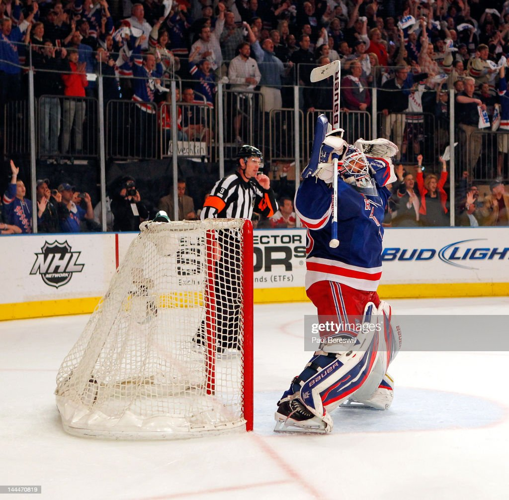 Goalie <a gi-track='captionPersonalityLinkClicked' href=/galleries/search?phrase=Henrik+Lundqvist&family=editorial&specificpeople=217958 ng-click='$event.stopPropagation()'>Henrik Lundqvist</a> #30 of the New York Rangers celebrates after they won 2-1 against the Washington Capitals in Game Seven of the Eastern Conference Semifinals during the 2012 NHL Stanley Cup Playoffs at Madison Square Garden on May 12, 2012 in New York City.