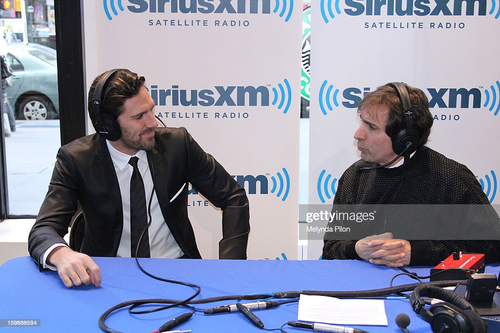 Goalie Henrik Lundqvist (L) of the New York Rangers is interviewed by Chris Russo on Sirius XM Radio at the NHL Powered by Reebok Store on January 22, 2013 in New York City.