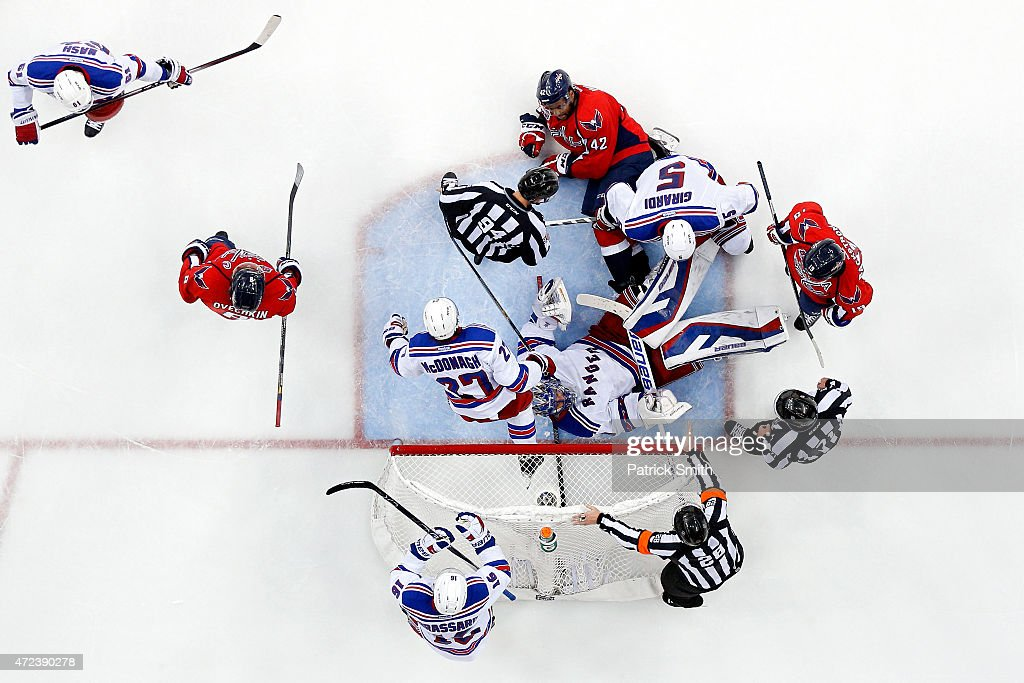 Goalie <a gi-track='captionPersonalityLinkClicked' href=/galleries/search?phrase=Henrik+Lundqvist&family=editorial&specificpeople=217958 ng-click='$event.stopPropagation()'>Henrik Lundqvist</a> #30 of the New York Rangers lays on his back after making a save on <a gi-track='captionPersonalityLinkClicked' href=/galleries/search?phrase=Joel+Ward+-+Ice+Hockey+Player&family=editorial&specificpeople=7231959 ng-click='$event.stopPropagation()'>Joel Ward</a> #42 of the Washington Capitals during the third period in Game Four of the Eastern Conference Semifinals during the 2015 NHL Stanley Cup Playoffs at Verizon Center on May 6, 2015 in Washington, DC. The Washington Capitals won, 2-1.