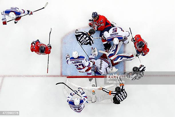 Goalie Henrik Lundqvist of the New York Rangers lays on his back after making a save on Joel Ward of the Washington Capitals during the third period...