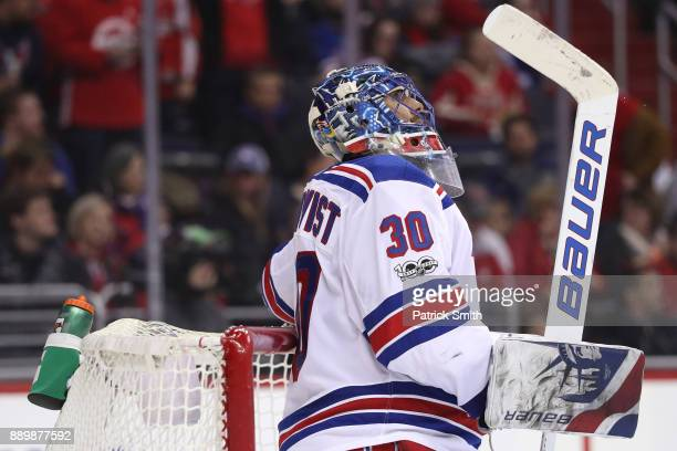 Goalie Henrik Lundqvist of the New York Rangers looks on after allowing a goal to Nicklas Backstrom of the Washington Capitals during the second...