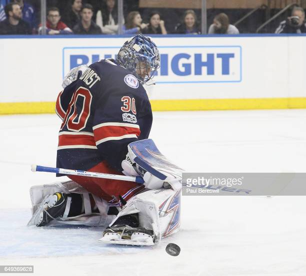 Goalie Henrik Lundqvist of the New York Rangers makes a save in an NHL hockey game against the Montreal Canadiens at Madison Square Garden on March 4...
