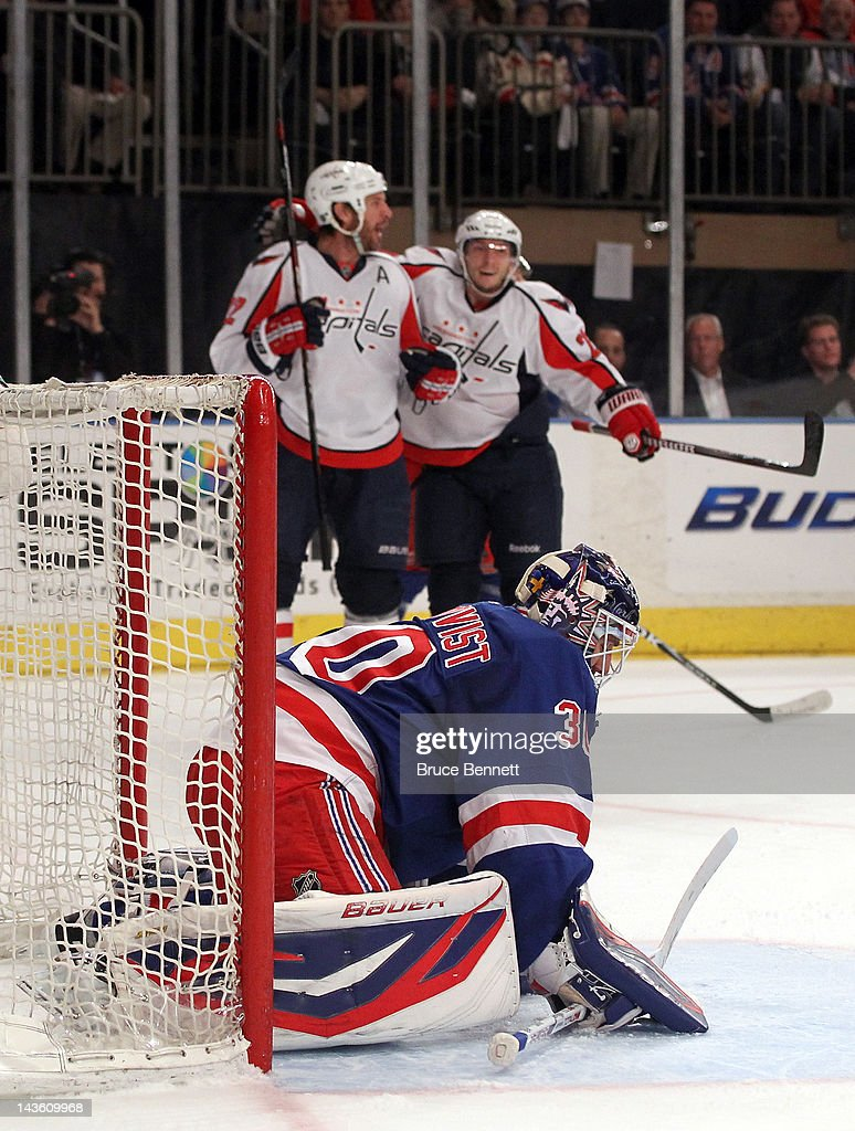 Goalie <a gi-track='captionPersonalityLinkClicked' href=/galleries/search?phrase=Henrik+Lundqvist&family=editorial&specificpeople=217958 ng-click='$event.stopPropagation()'>Henrik Lundqvist</a> #30 of the New York Rangers reacts as <a gi-track='captionPersonalityLinkClicked' href=/galleries/search?phrase=Mike+Knuble&family=editorial&specificpeople=202077 ng-click='$event.stopPropagation()'>Mike Knuble</a> #22 and <a gi-track='captionPersonalityLinkClicked' href=/galleries/search?phrase=Keith+Aucoin&family=editorial&specificpeople=2125652 ng-click='$event.stopPropagation()'>Keith Aucoin</a> #23 of the Washington Capitals celebrate after Knuble scored in the first period in Game Two of the Eastern Conference Semifinals during the 2012 NHL Stanley Cup Playoffs at Madison Square Garden on April 30, 2012 in New York City.