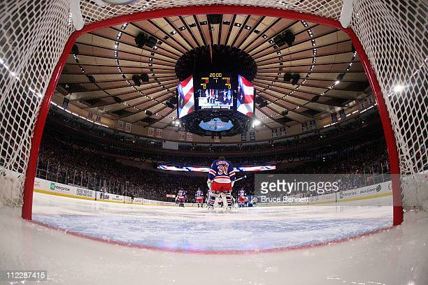 Goalie Henrik Lundqvist of the New York Rangers stands on the ice during the performance of the National Anthem against the Washington Capitals in...