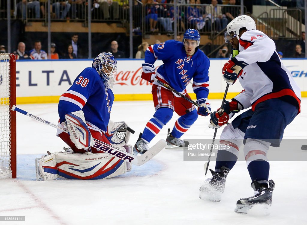 Goalie <a gi-track='captionPersonalityLinkClicked' href=/galleries/search?phrase=Henrik+Lundqvist&family=editorial&specificpeople=217958 ng-click='$event.stopPropagation()'>Henrik Lundqvist</a> #30 of the New York Rangers stops a shot by Joel Ward #42 of the Washington Capitals as <a gi-track='captionPersonalityLinkClicked' href=/galleries/search?phrase=Ryan+McDonagh&family=editorial&specificpeople=4324983 ng-click='$event.stopPropagation()'>Ryan McDonagh</a> #27 of the Rangers moves in during the third period of Game Six of the Eastern Conference Quarterfinals during the 2013 NHL Stanley Cup Playoffs at Madison Square Garden on May 12, 2013 in New York City. Rangers won 1-0.