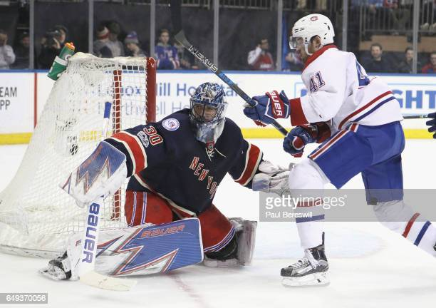Goalie Henrik Lundqvist of the New York Rangers stops a shot by Paul Byron of the Montreal Canadiens in an NHL hockey game at Madison Square Garden...
