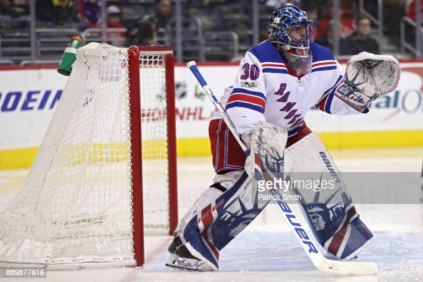 Goalie Henrik Lundqvist of the New York Rangers tends the net against the Washington Capitals during the second period at Capital One Arena on...
