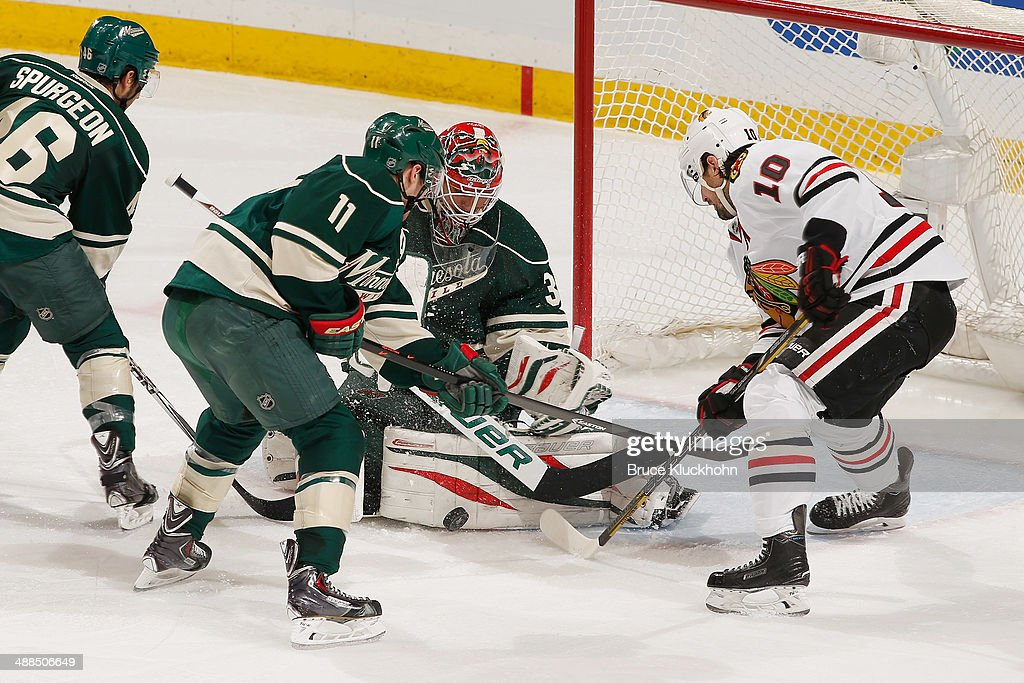 Goalie Ilya Bryzgalov #30 and his Minnesota Wild teammate Zach Parise #11 protect their goal against Patrick Sharp #10 and the Chicago Blackhawks during Game Three of the Second Round of the 2014 Stanley Cup Playoffs on May 6, 2014 at the Xcel Energy Center in St. Paul, Minnesota.