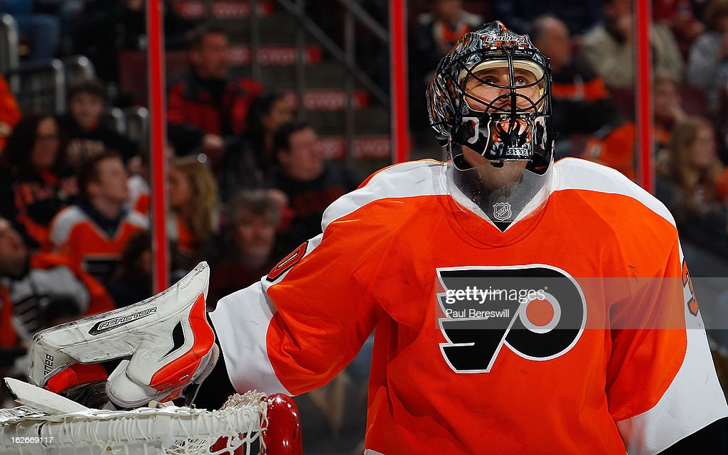 Goalie <a gi-track='captionPersonalityLinkClicked' href=/galleries/search?phrase=Ilya+Bryzgalov&family=editorial&specificpeople=2285430 ng-click='$event.stopPropagation()'>Ilya Bryzgalov</a> #30 of the Philadelphia Flyers looks up ln the air after giving up a goal in the first period of an NHL Hockey game against the Toronto Maple Leafs at Wells Fargo Center on February 25, 2013 in Philadelphia, Pennsylvania.