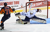 Goalie Jack Finn of the Mississauga Steelheads makes a save on Bryce Yetman of the Flint Firebirds during OHL game action on October 4 2015 at the...