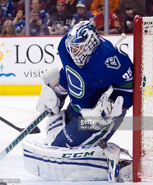 Goalie Jacob Markstrom makes a save during NHL action against the Calgary Flames on April 13 2014 at Rogers Arena in Vancouver British Columbia Canada