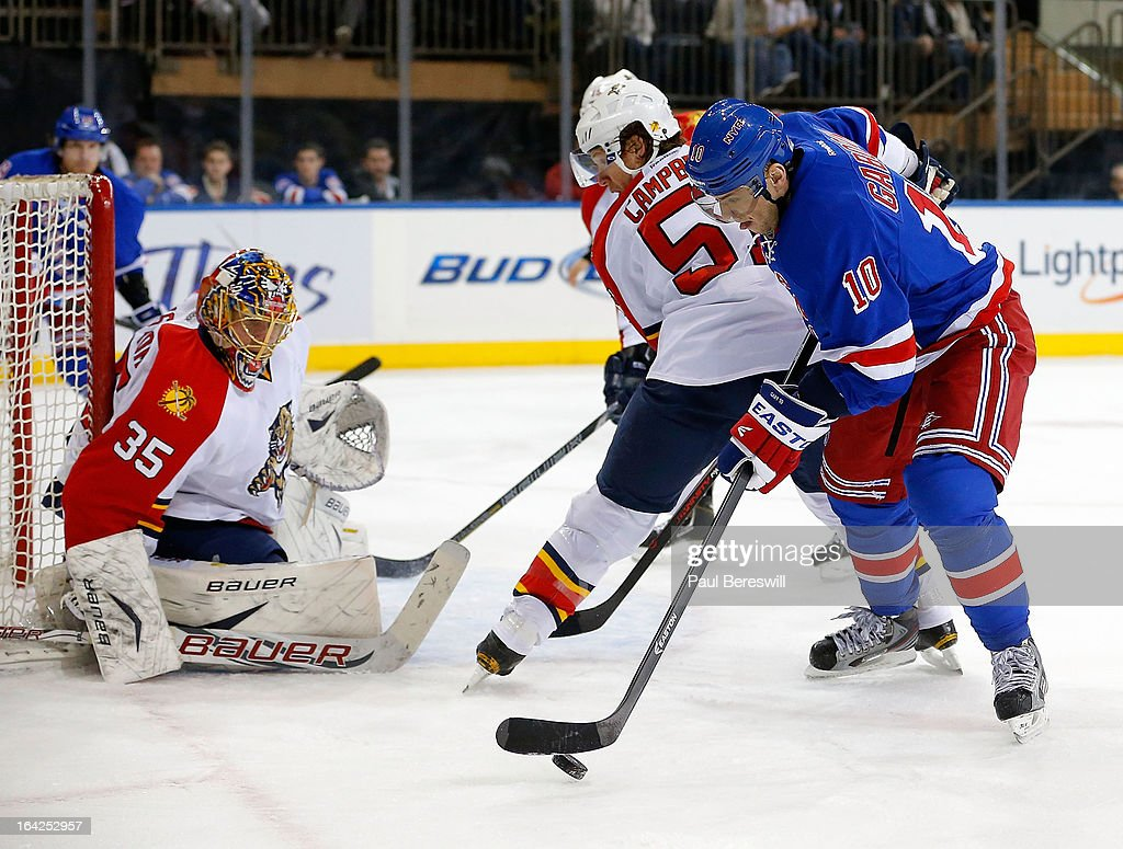 Goalie Jacob Markstrom #35 of the Florida Panthers protects his goal as Marian Gaborik #10 of the New York Rangers controls the puck during the second period of an NHL hockey game at Madison Square Garden on March 21, 2013 in New York City. Panthers won 3-1.