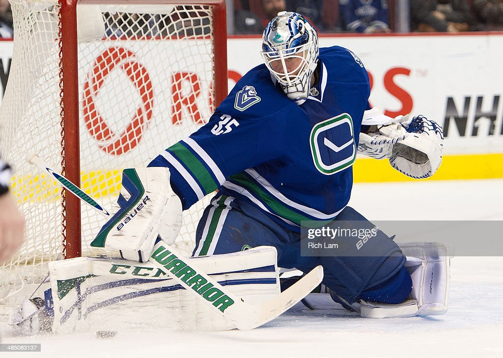 Goalie Jacob Markstrom #35 of the Vancouver Canucks makes a pad save during NHL action against the Colorado Avalanche on April 10, 2014 at Rogers Arena in Vancouver, British Columbia, Canada.