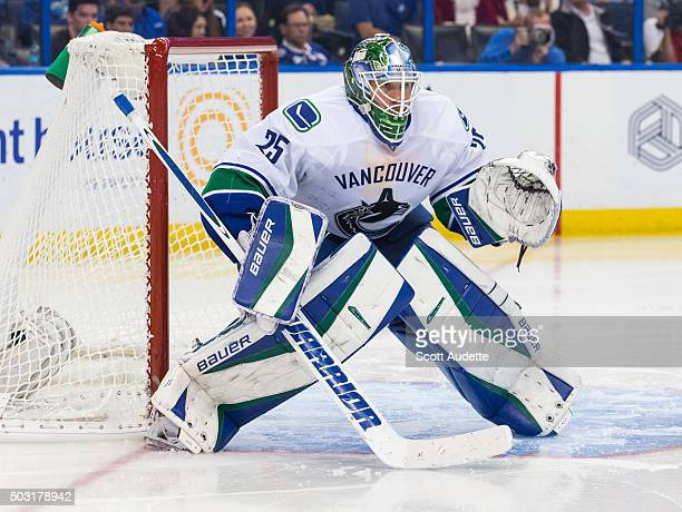 Goalie Jacob Markstrom of the Vancouver Canucks skates against the Tampa Bay Lightning at the Amalie Arena on December 22 2015 in Tampa Florida