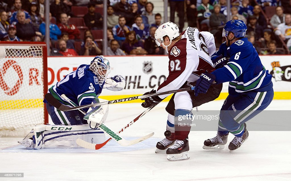 Goalie <a gi-track='captionPersonalityLinkClicked' href=/galleries/search?phrase=Jacob+Markstrom&family=editorial&specificpeople=5370948 ng-click='$event.stopPropagation()'>Jacob Markstrom</a> #35 of the Vancouver Canucks stops <a gi-track='captionPersonalityLinkClicked' href=/galleries/search?phrase=Gabriel+Landeskog&family=editorial&specificpeople=6590816 ng-click='$event.stopPropagation()'>Gabriel Landeskog</a> #92 of the Colorado Avalanche in close while <a gi-track='captionPersonalityLinkClicked' href=/galleries/search?phrase=Yannick+Weber&family=editorial&specificpeople=4324944 ng-click='$event.stopPropagation()'>Yannick Weber</a> #6 of the Canucks helps defend during the third period in NHL action on April 10, 2014 at Rogers Arena in Vancouver, British Columbia, Canada.