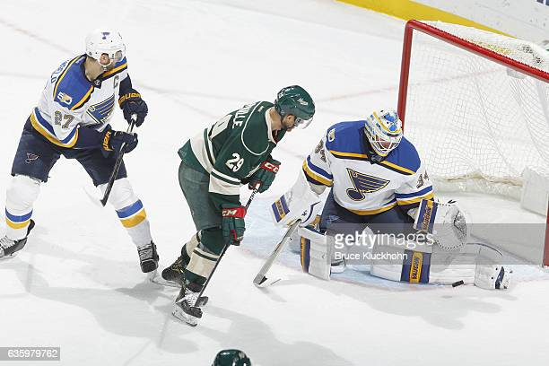Goalie Jake Allen makes a save while his St Louis Blues teammate Alex Pietrangelo defends Jason Pominville of the Minnesota Wild during the game on...