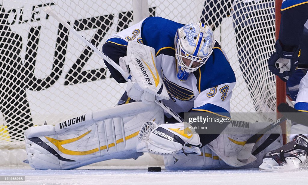 Goalie Jake Allen #34 of the St. Louis Blues covers up the puck during NHL action against the Vancouver Canucks on March 19, 2013 at Rogers Arena in Vancouver, British Columbia, Canada.