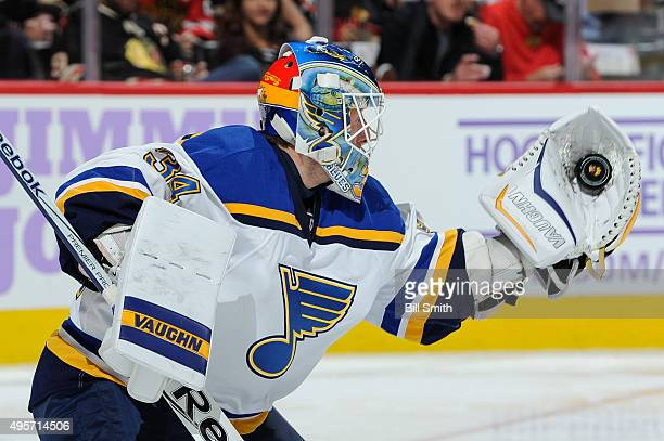 Goalie Jake Allen of the St Louis Blues gloves the puck in the second period of the NHL game against the Chicago Blackhawks at the United Center on...