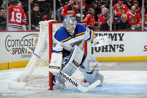 Goalie Jake Allen of the St Louis Blues guards the net during the NHL game against the Chicago Blackhawks at the United Center on December 3 2014 in...