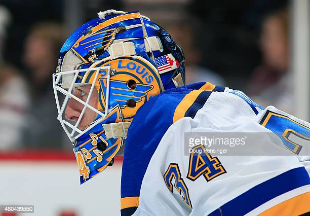 Goalie Jake Allen of the St Louis Blues looks on as he defends the goal against the Colorado Avalanche at Pepsi Center on December 13 2014 in Denver...